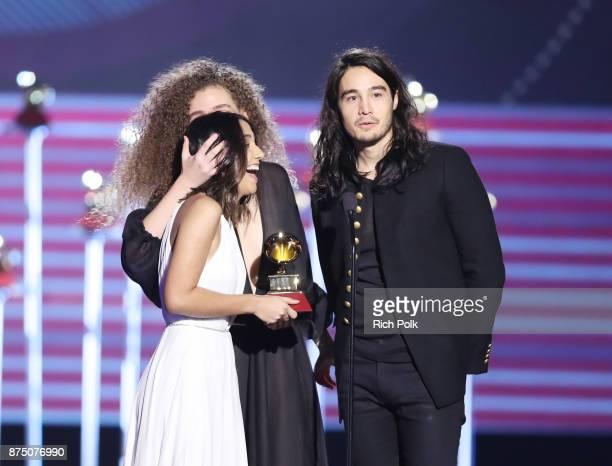 Ana Caetano Vitoria Falcao and Tiago Iorc accept Best Song in the Portuguese Language for 'Trevo ' onstage at the Premiere Ceremony during the 18th...