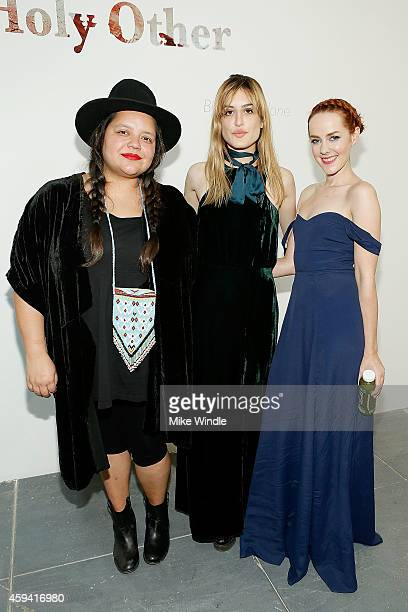 Ana Calderon Ioanna Gika and Jena Malone attend The Holy Other A Series Of Photos by Jena Malone Opening Reception on November 21 2014 in Los Angeles...