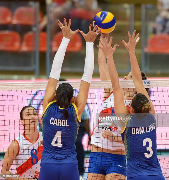Ana Carolina Da Silva and Danielle Lins of Brazil attemp to block the spike ball from Serbia player during their FIVB World Grand Prix...