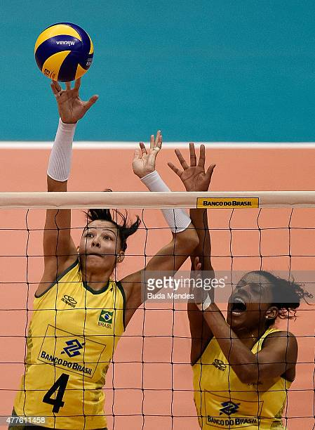 Ana Carolina da Silva and Fernada Garay of Brazil block the ball during the Brazil v Japan Volleyball Challenge at Maracanazinho on June 18 2015 in...