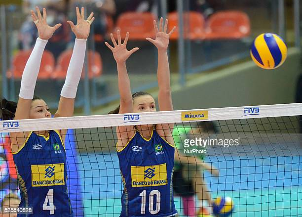 Ana Carolina Da Silva and Gabriela Braga Guimaraes of Brazil attemp to block the ball during the FIVB World Grand Prix intercontinental round match...