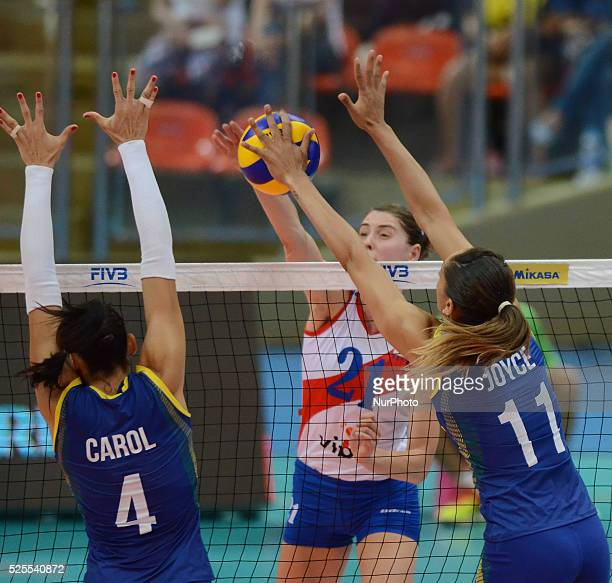 Ana Carolina Da Silva and Joyce Silva of Brazil attemp to block the ball from Bianka Busa of Serbia during their FIVB World Grand Prix...