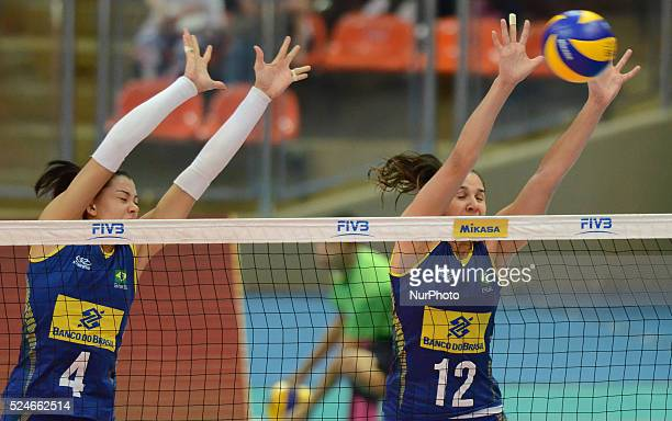 Ana Carolina Da Silva and Natalia Pereira of Brazil attemp to block the ball during the FIVB World Grand Prix intercontinental round match against...