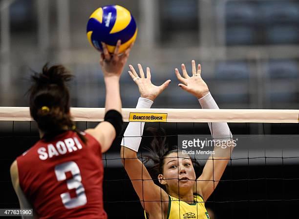 Ana Carolina da Silva attempts a block during the Brazil v Japan Volleyball Challenge at Maracanazinho on June 18 2015 in Rio de Janeiro Brazil