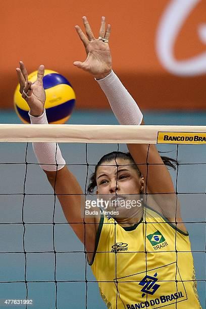 Ana Carolina da Silva blocks the ball during the Brazil v Japan Volleyball Challenge at Maracanazinho on June 18 2015 in Rio de Janeiro Brazil