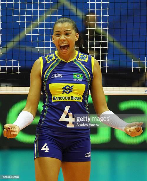 Ana Carolina Da Silva of Brazil celebrates the score during the 2014 FIVB Volleyball Women's World Championship Group B match between Brazil and...