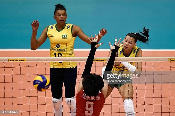 Ana Carolina da Silva of Brazil spikes the ball during the Brazil v Japan Volleyball Challenge at Maracanazinho on June 18 2015 in Rio de Janeiro...