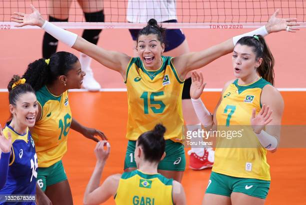 Ana Carolina da Silva of Team Brazil reacts with team mates as they compete against Team South Korea during the Women's Semifinals on day fourteen of...