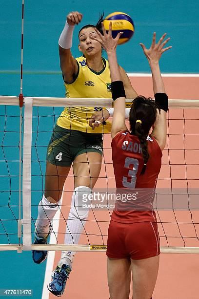 Ana Carolina da Silva spikes the ball during the Brazil v Japan Volleyball Challenge at Maracanazinho on June 18 2015 in Rio de Janeiro Brazil