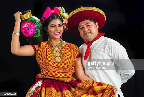 Ana Cinthia Quintana and Antonio Perez from Asuncion Ixtaltepec pose during a rehearsal for the Guelaguetza traditional festival in Oaxaca Mexico on...