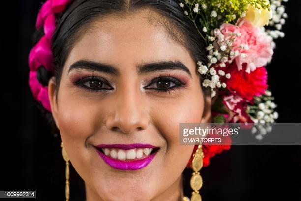 Ana Cinthia Quintana from Asuncion Ixtaltepec poses during a rehearsal for the Guelaguetza traditional festival in