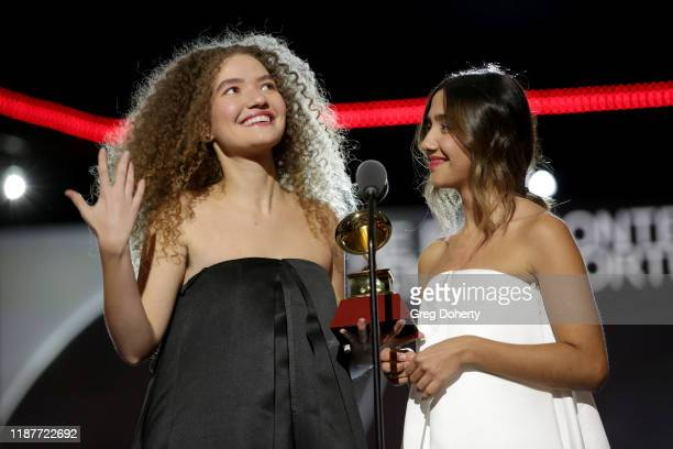 Ana Clara Caetano and Vitória Falcão of the duo Anavitoria accept the award for Best Portuguese Language Contemporary Album onstage at the Premiere...