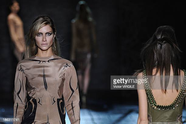 Ana Claudia Michels walks the runway during Animale show at Sao Paulo Fashion Week Winter 2014 on October 28 2013 in Sao Paulo Brazil