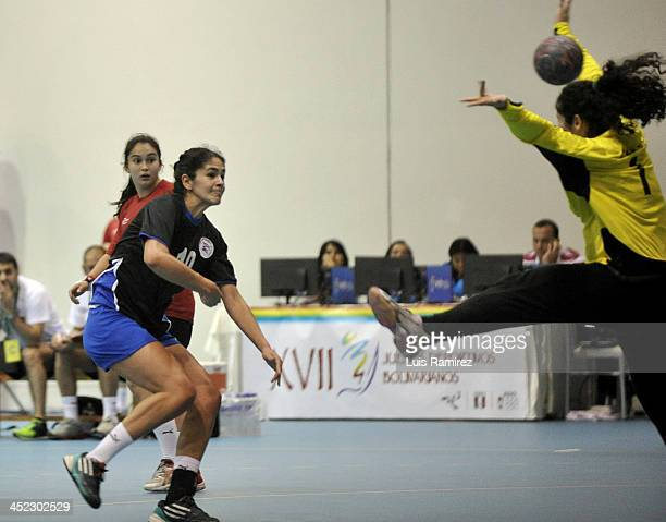 Ana Cristaldo of Paraguay vies for the ball with Flavia Jara of Chile during a match between Paraguay and Chile in Women's handball as part of the...