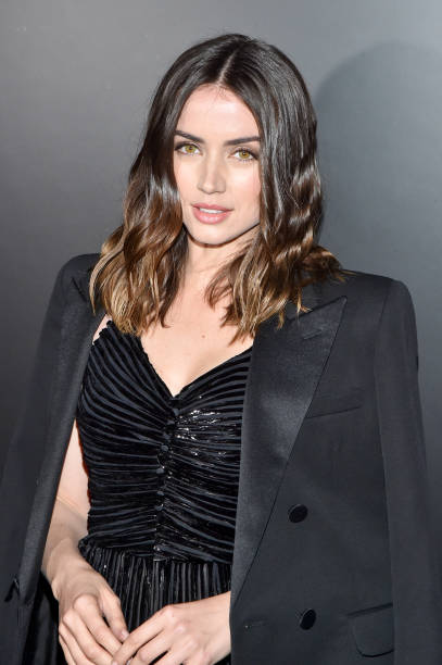 In this handout photo provided by NBCUniversal Media LLC Ana de Armas and Daniel Craig speak onstage during the 77th Annual Golden Globe Awards at...
