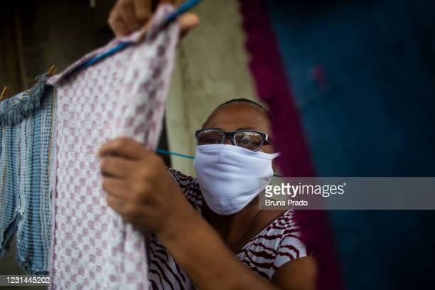 Ana de Oliveira, 61 years old, mother of a dead son victim violence, resident dof Complexo da Mare slum arranges the clothes on the balcony of her...