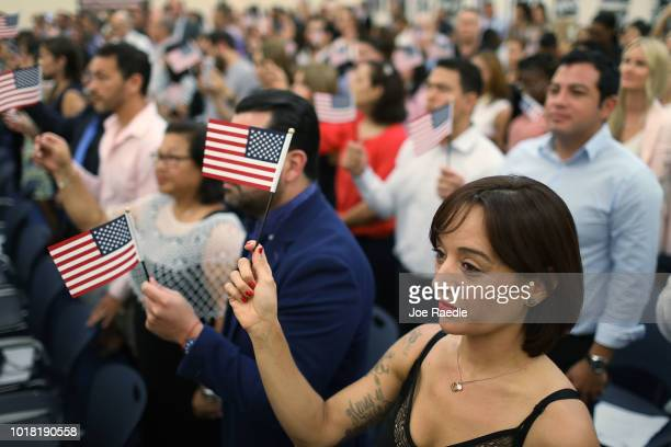 Ana Delia orginally from Spain participates in a ceremony to become an American citizen during a US Citizenship Immigration Services naturalization...