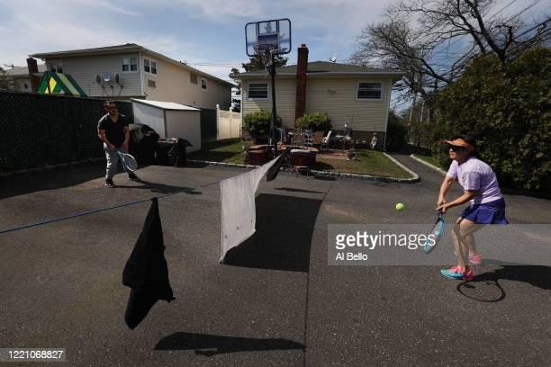 Ana Diaz who is a nurse at Northwell Syosset Hospital plays tennis with her Son Mel Diaz who is a Patient Transporter at Northwell Manhasset Hospital...