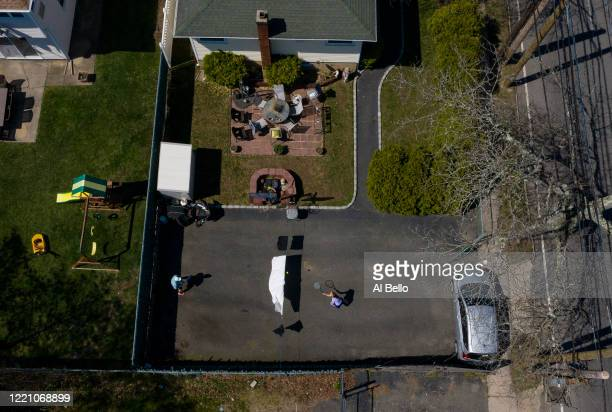 Ana Diaz who is a nurse at Northwell Syosset Hospital plays tennis with her Husband Melanio Diaz at their home on a makeshift court they created in...