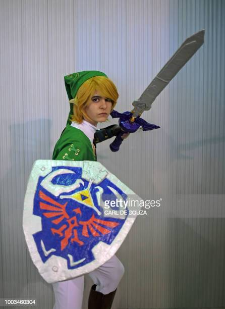 Ana Elisa Macedo de Figueiredo wears a costume resembling the character Link from the Nintendo Zelda video game at The Geek and Game Expo in Rio de...