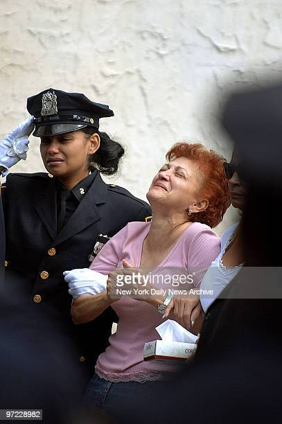 Ana Fernandez grieves as the coffin of her daughter rookie NYPD Officer Marlene Rivera is carried into the Metropolitan International Church in...