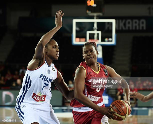 Ana Flavia De Azinheira of Mozambique drives towards the hoop against her rival Ingrid Tanqueray of France during the 2014 FIBA World Championship...