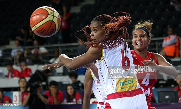 Ana Flavia De Azinheira of Mozambique in action against MianMarie Langlois of Canada during the 2014 FIBA World Championship For Women Group B...