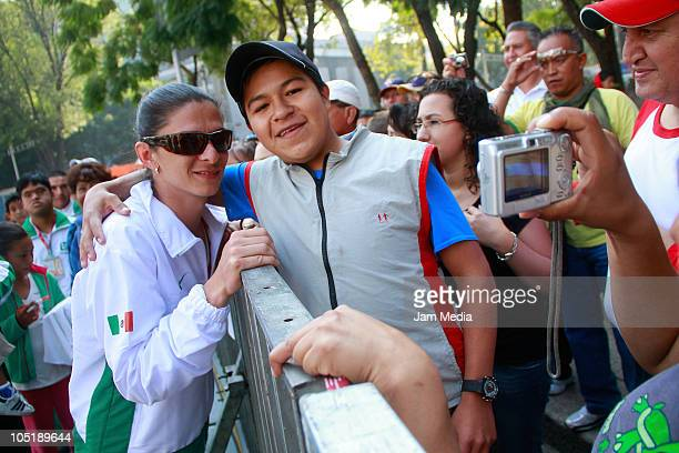 Ana Gabriela Guevara poses with a supporter during the Festival Olimpico Bicentenario at the Paseo de la Reforma Avenue on October 10 2010 in Mexico...