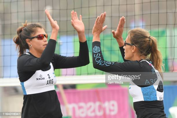 Ana Galay and Fernanda Pereyra of Argentina celebrate during a Women's Beach Volleyball Preliminary - Group D match between Argentina and Guatemala...