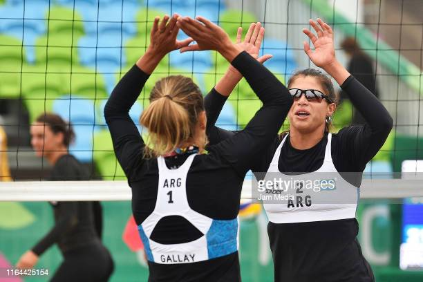 Ana Gallay and Fernanda Pereyra of Argentina celebrate during the Women's Beach Volleyball Preliminary - Group D match between Canada and Argentina...