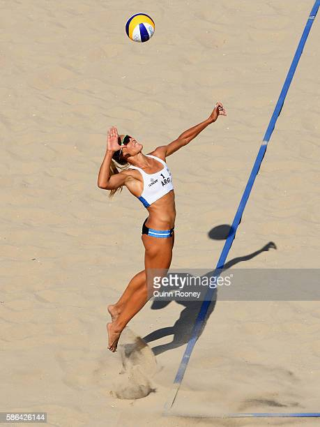 Ana Gallay of Argentina serves during the Women's Beach Volleyball preliminary round Pool B match against Liliana Fernandez Steiner and Elsa...