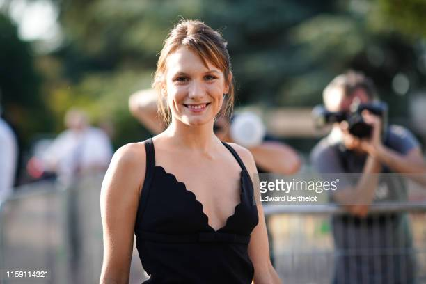 Ana Girardot wears a black low neck dress outside Miu Miu Club 2020 on June 29 2019 in Paris France