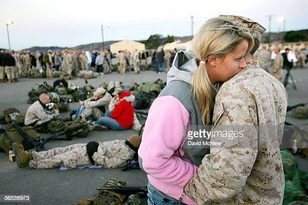 Ana Goad and Marine CPL Michael Goad say good-bye as members of the 3rd Battalion, 5th Marine Regiment leave on a seven-month deployment to the Al...