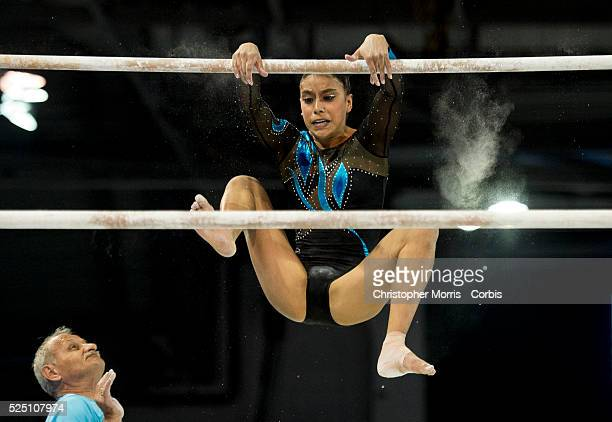 Ana Gomez Porras of Guatemala falls off the uneven bars during the women's all around artistic gymnastics competition at the 2015 PanAm Games in...