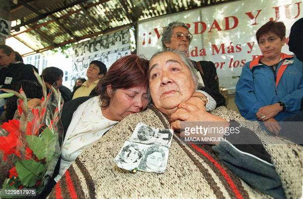 Ana Gonzalez , who lost four relatives to the repression during the 1973-1990 dictatorship of Gen. Augusto Pinochet, reacts with a friend to the...