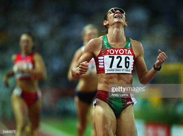 Ana Guevara of Mexico celebrates her victory in the 400m final during the 9th IAAF World Athletics Championship August 27 2003 in Paris