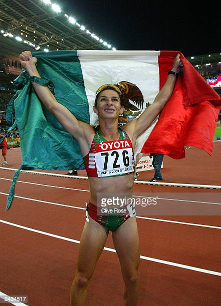 Ana Guevara of Mexico celebrates winning the gold in the Womens 400m Final at the 9th IAAF World Athletics Championship August 27 2003 in Paris