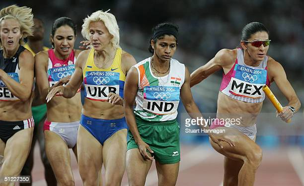 Ana Guevara of Mexico competes in the women's 4 x 400 metre relay on August 27 2004 during the Athens 2004 Summer Olympic Games at the Olympic...