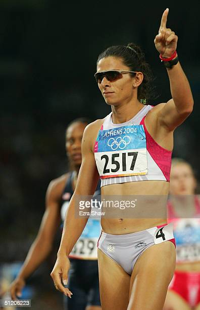 Ana Guevara of Mexico reacts after the women's 400 metre semifinal on August 22 2004 during the Athens 2004 Summer Olympic Games at the Olympic...