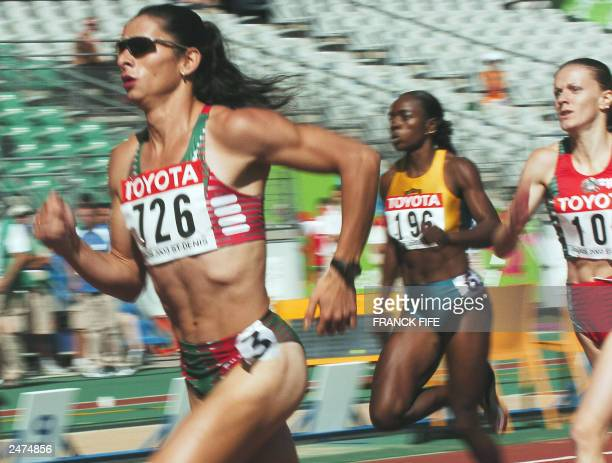 Ana Guevara of Mexico speeds to victory in heat one of the women's 400m ahead of second placed Svetlana Usovich of Bulgaria and Cameroon's Mireille...