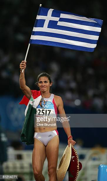 Ana Guevara of Mexico waves a flag after she finished second and won the silver medal in the 400 metre final on August 24 2004 during the Athens 2004...