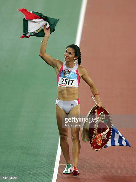 Ana Guevara of Mexico waves to the crowd after she finished second in the women's 100 metre hurdle final on August 24 2004 during the Athens 2004...