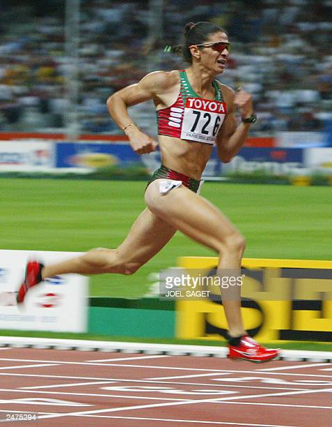 Ana Guevara of Mexico wins the women's 400m final 27 August 2003 during the 9th IAAF World Athletics Championships at the Stade de France in...