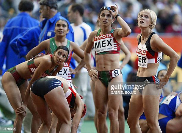 Ana Guevera of Mexico looks at the results board after the women's 4x400 relay first round 30 August 2003 during the 9th IAAF World Athletics...