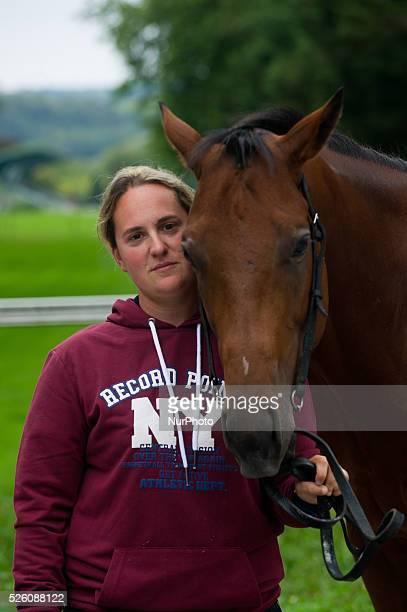 Ana Imaz freshbrewed and trainer of racehorses alongside one of his horses Muqawel in the hippodrome of San Sebastian on september 10 2015