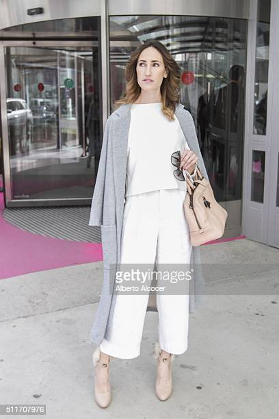 Ana Iriberri wears Loewe shoes Loewe handbag Vintage top and Zara coat during Mercedes Benz Fashion Week at Ifema on February 19 2016 in Madrid Spain