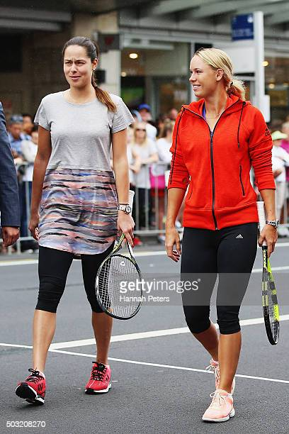 Ana Ivanovic and Caroline Wozniacki arrive to take part in an exhibition tennis match withon January 3 2016 in Auckland New Zealand The ASB Classic...