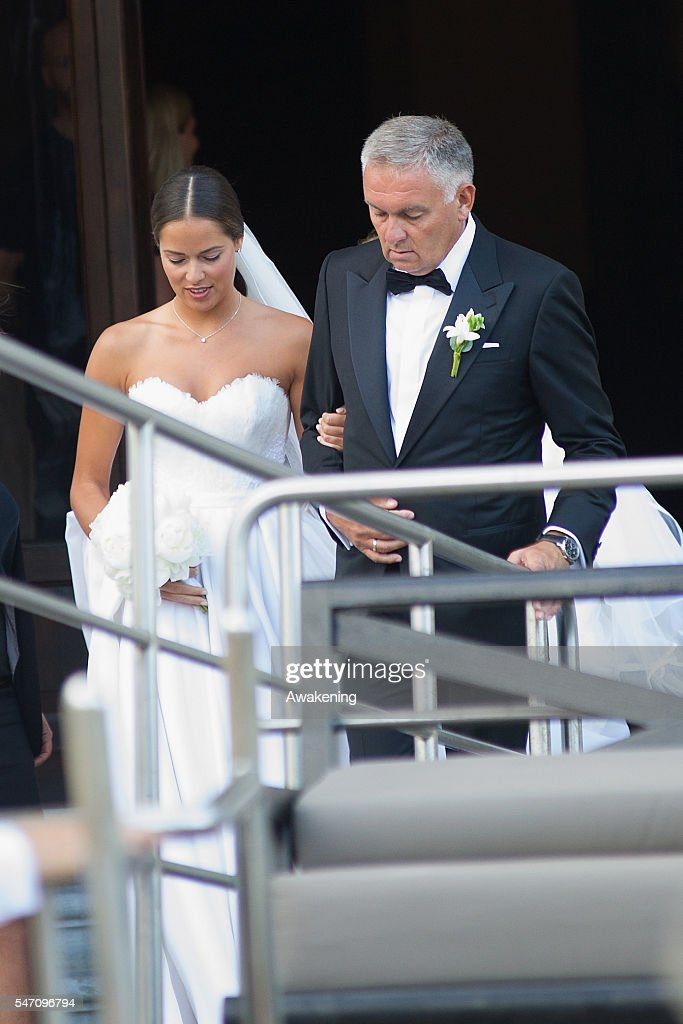 Ana Ivanovic and her father Miroslav Ivanovic leave the Aman Grand Canal Hotel to reach the church for the wedding to Bastian Schweinsteiger on July 13, 2016 in Venice, Italy.