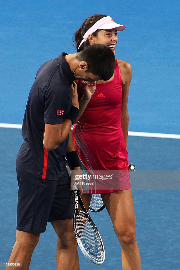 Ana Ivanovic and Novak Djokovic of Serbia laugh together in their mixed doubles match against Tatjana Malek and Thanasi Kokkinakis of Germany during day seven of the Hopman Cup at Perth Arena on January 4, 2013 in Perth, Australia.