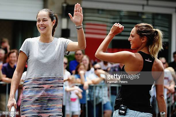 Ana Ivanovic and TV presenter Makere Bradnam celebrate a point during an exhibition tennis match withon January 3 2016 in Auckland New Zealand The...